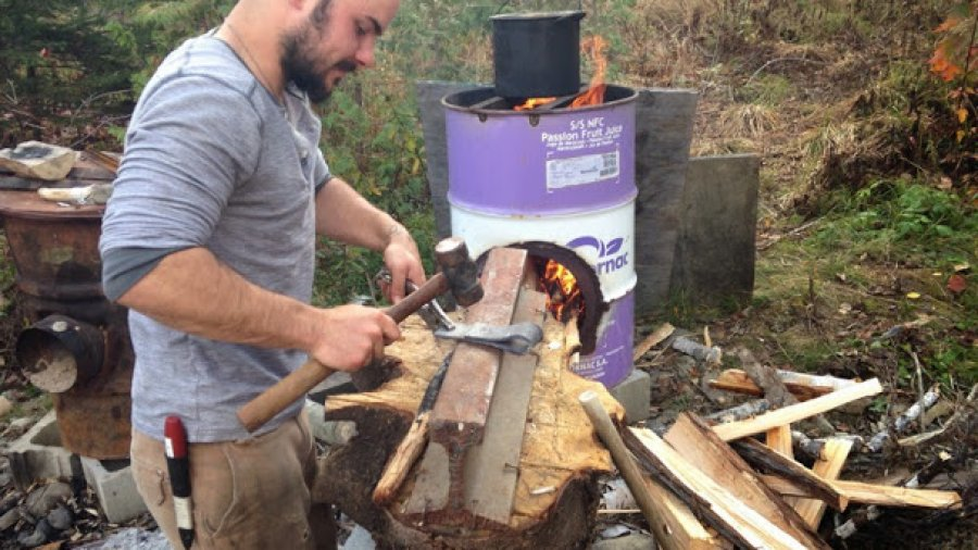 Making a simple axe head with the big rocket stove as a heat source
