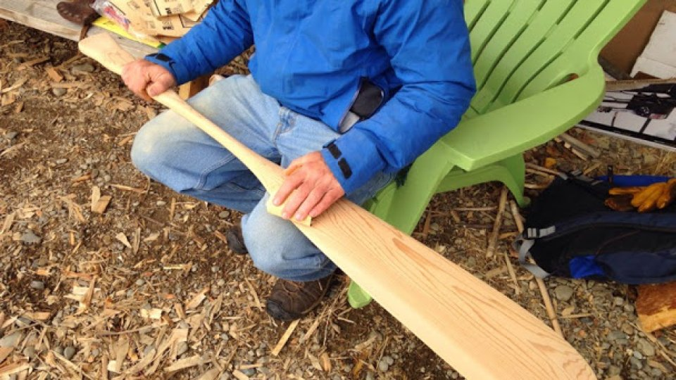 Sanding a new canoe paddle made with simple hand tools