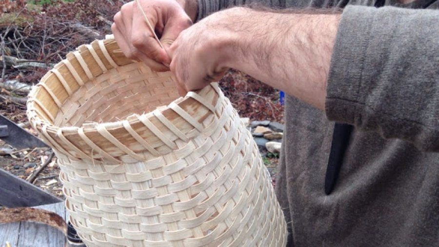 Putting a rim on a newly made pack basket