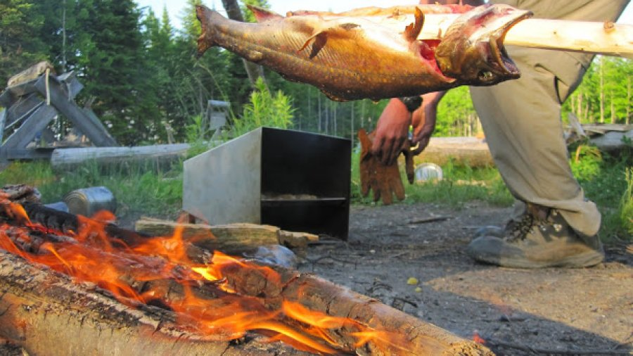 Brook trout over the fire, sourdough biscuits in the reflector oven
