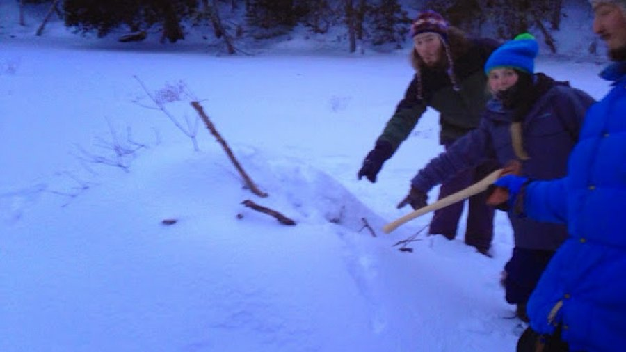 Checking out the vent hole on an active beaver lodge during the winter woodsman course