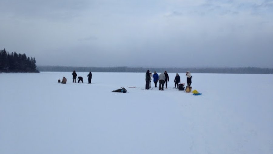 Fishing and ice safety on the lake during the winter woodsman course