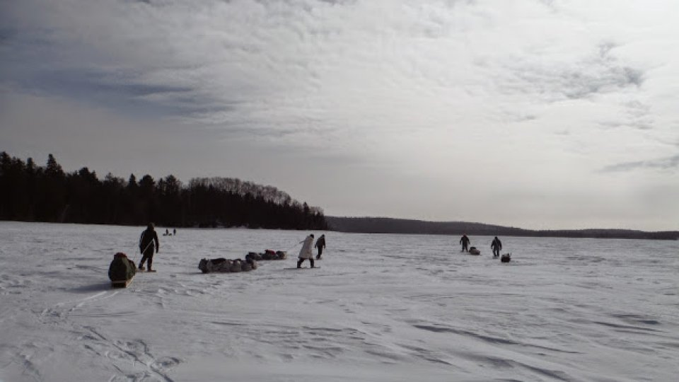 Hauling toboggans after the lunch stop on a perfect winter day