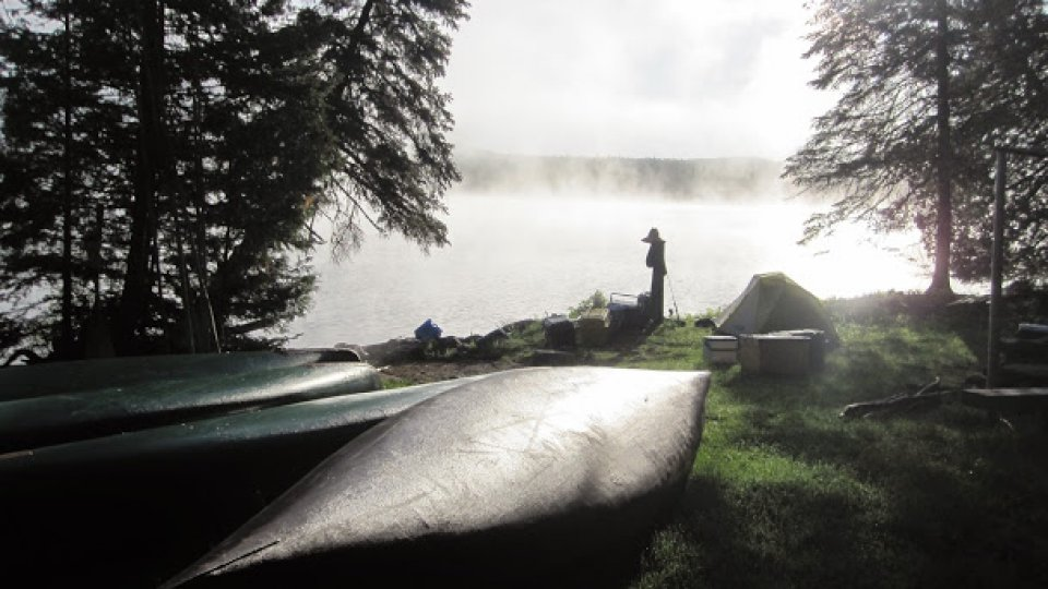 Mist and bright sunlight at Round Pond on the Allagash