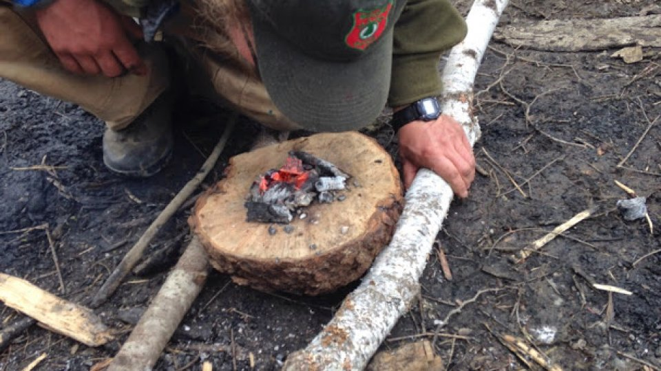Coal burning a burl to make a wooden bowl