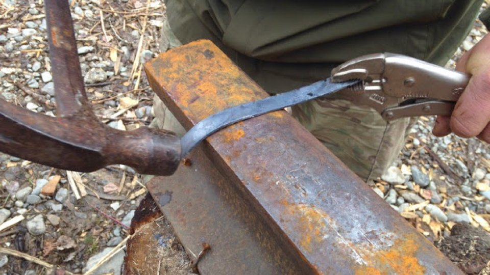 Bending crooked knives, heated in a small rocket stove