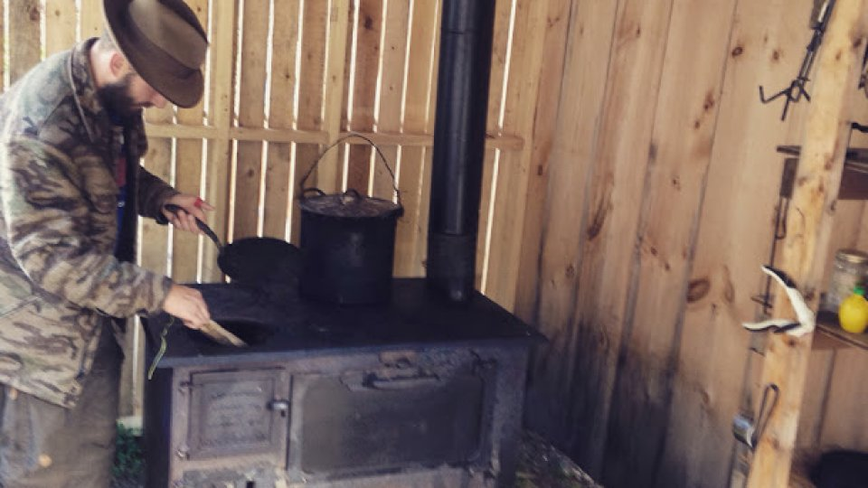 Putting wood in the stove