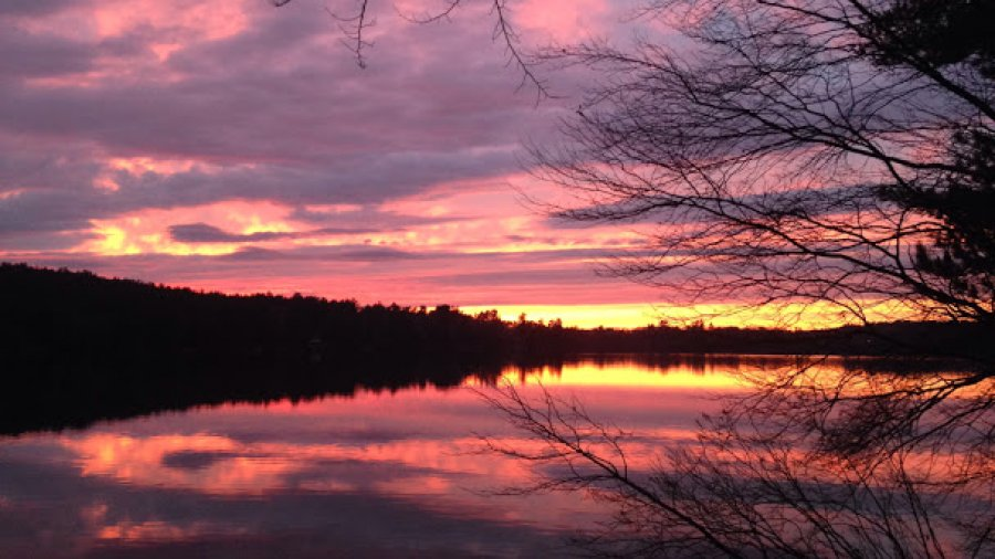 Gloomy day, stunning sunset over Rust Pond