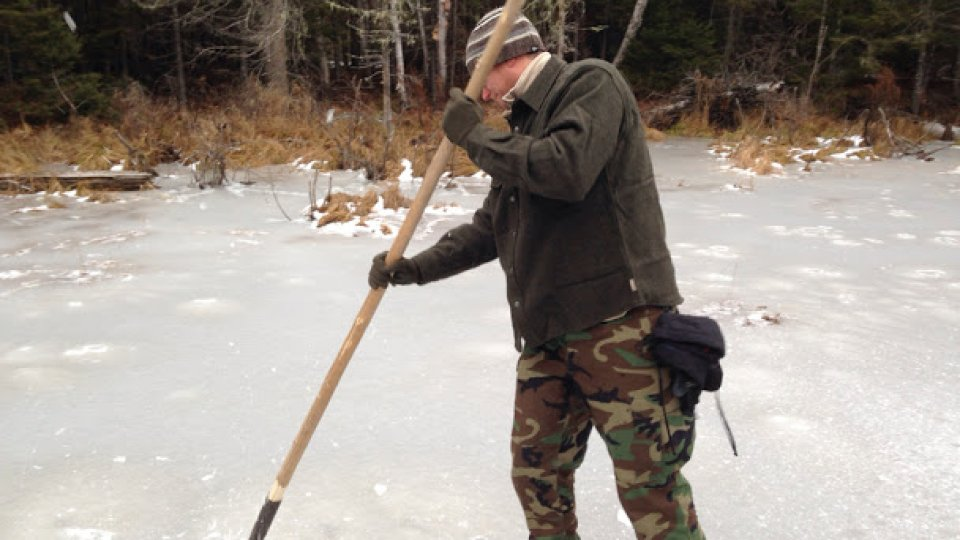 Checking the ice with a chisel