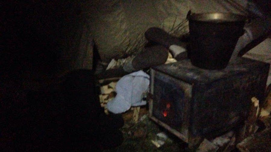 Cozy camp next to a frozen lake