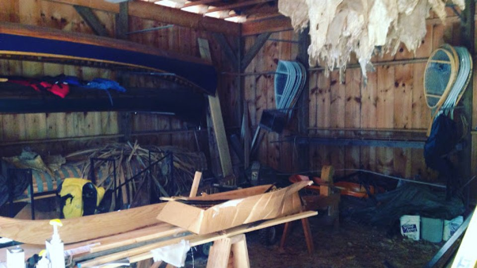 Organizing the barn this AM: canoe mold, deer hides, traps, snowshoe molds, tools, pack basket materials, knife blanks, etc