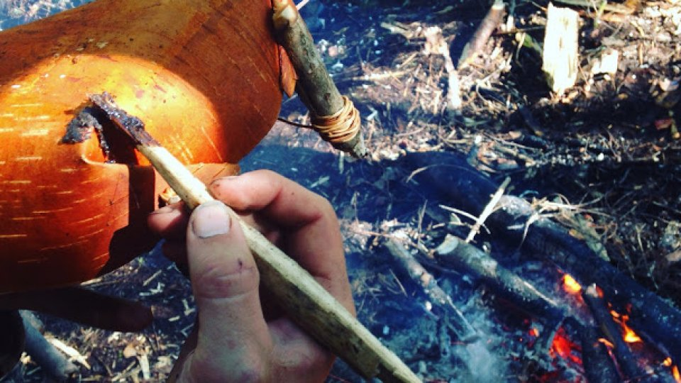 Sealing a crack in a birch bowl with pitch to make it water tight