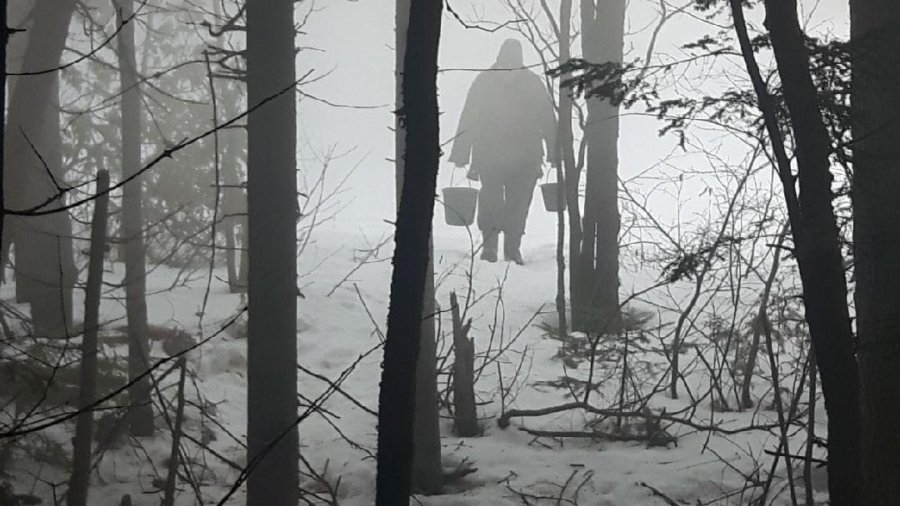 Carrying Water Pails In The Mist