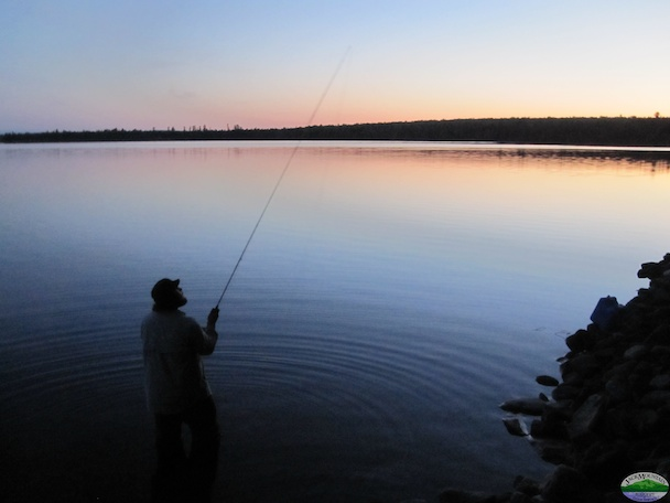 Casting a fly at dusk.